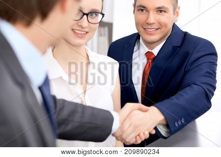 Two business man shaking hands to each other finishing up the meeting.