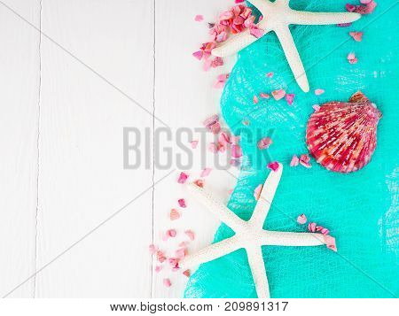 Seashells, Starfish On White Wooden Background, With Turquoise Cloth. Gentle Background, A Backgroun
