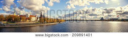 Panorama of Latvian capital Riga on the banks of the Daugava on a sunny autumn day