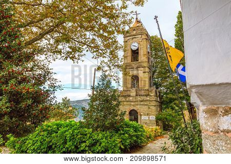 Street view and old church in Portaria, village in Pelion, Thessaly, Greece
