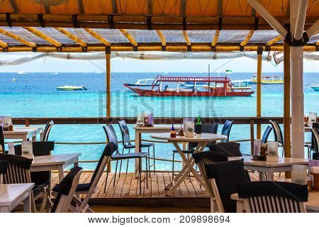 Interior of a cafe on the background of azure sea. Gili Trawangan, Indonesia.