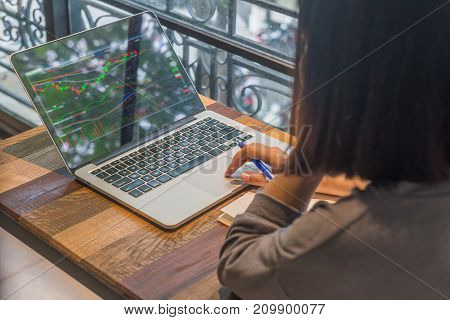 Freelancer investor watch the change of stock market on laptop