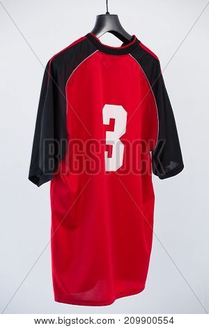 Close-up of football jersey fabric against white background