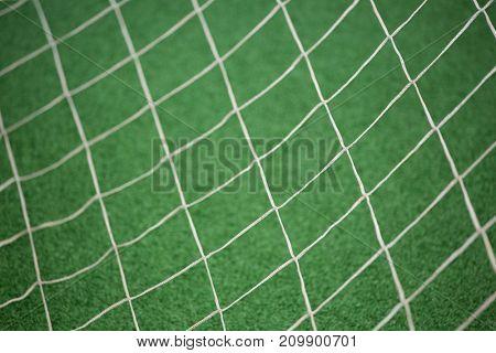 Close-up of football goalpost against artificial grass
