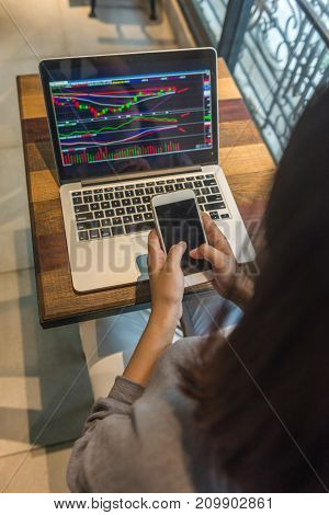 Stock trader using phone to buy shares on stock market