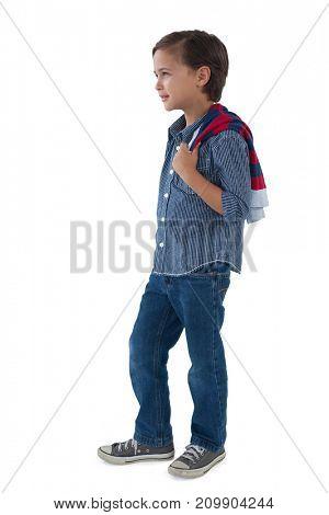 Cute boy posing against white background