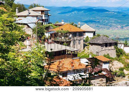 Panorama of houses in bulgarian high mountain village or selo Delchevo, Bulgaria, Balkans