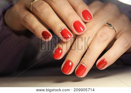 Hands Of A Woman With Red Manicure
