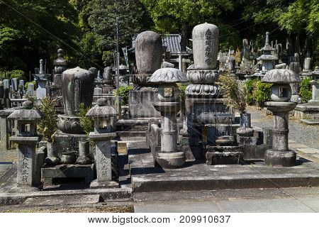 Kyoto, Japan - May 19, 2017: Old graves and headstones of the deceased at a Buddhist cemetery behind Chion-In temple in ancient Kyoto, Japan