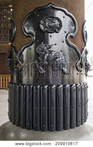 Kyoto, Japan -  May 23, 2017: Decoration of a guardian lion dog on a wooden pillar in the Higashi Honganji Temple
