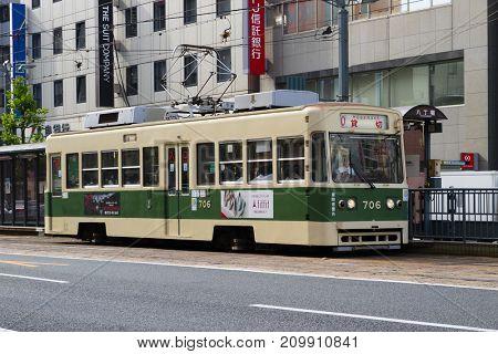 Hiroshima,Japan -  May 23, 2017: Streetcar as public transportation in Hatchobori street in Hiroshima