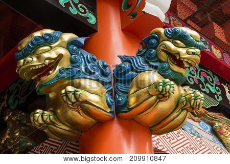 Tokyo, Japan - May 14, 2017:  Colorful wooden guardian lions as a decoration to guard the sacred temple