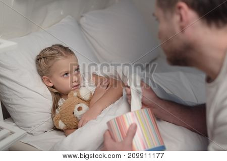 Father And Sick Daughter In Bed