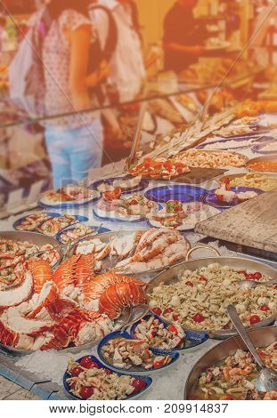 Showcase in a cafe with a large selection of seafood. Toned. The vertical frame.