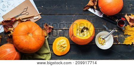 close up view hollow pumpkin knife object preparation to halloween holiday black background top view