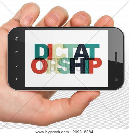 Politics concept: Hand Holding Smartphone with Painted multicolor text Dictatorship on display, 3D rendering