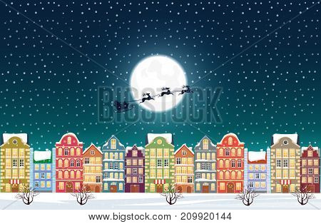Santa Claus flies over a decorated snowy old city town near moon at Christmas eve