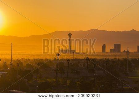 Las Vegas, Nevada, USA - October 10, 2017:  Hazy morning sunrise view towards Stratosphere tower on the Las Vegas strip.
