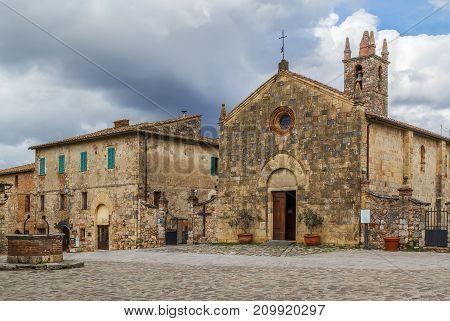 Church of Santa Maria assunta on Rome square in Monteriggioni Italy