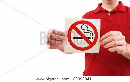a man holding a no smoking sign.