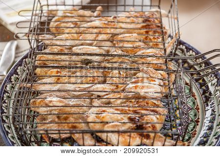 Dishes with the quail and grill for a celebratory family dinner before making for serving.. Horizontal frame.