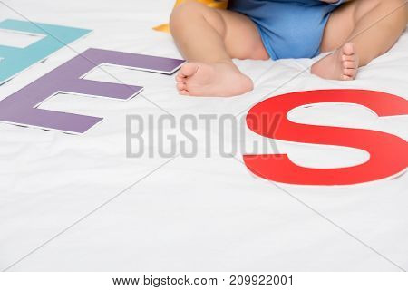 Baby And Paper Letters
