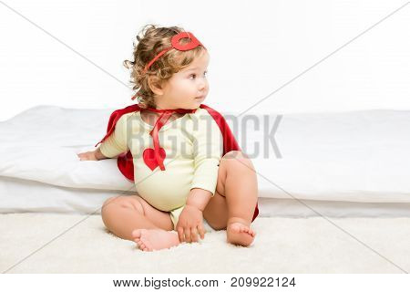 Toddler In Superhero Costume