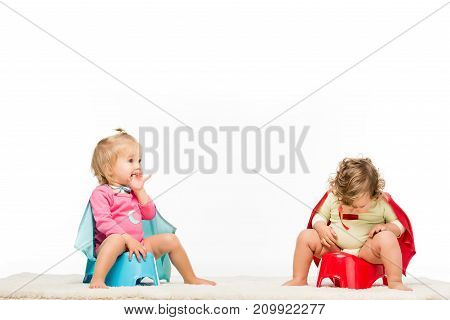 Toddlers Sitting On Potties