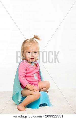 Toddler Girl Sitting On Pottie