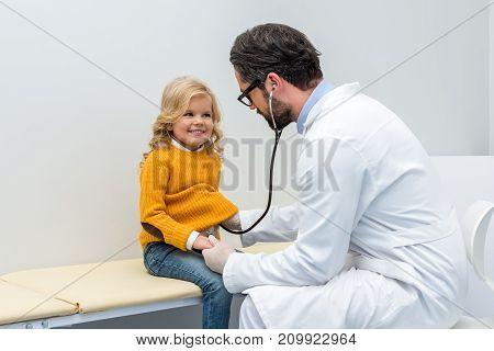 Pediatrist Listening To Breath Of Little Girl