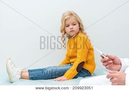 Pediatrist Preparing To Measure Temperature