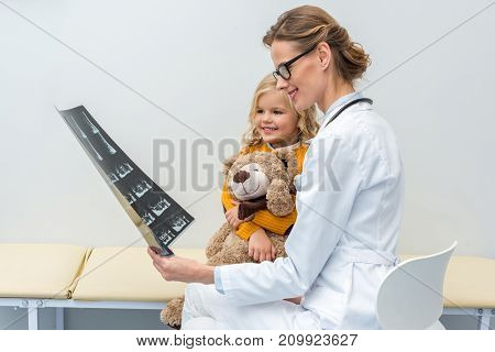 Doctor Showing X-ray To Little Patient