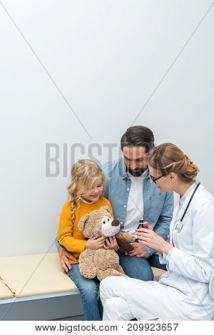 Doctor Giving Syrup To Teddy Bear
