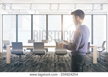 Attractive european businessman standing in modern conference room with equipment and sunlight. Employee worker excecutive concept. 3D Rendeirng