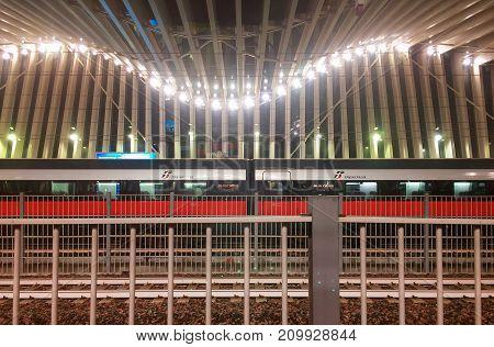 Reggio Emilia Italy october 12 2017: train standing in the modern Mediopadana railways station by Santiago Calatrava