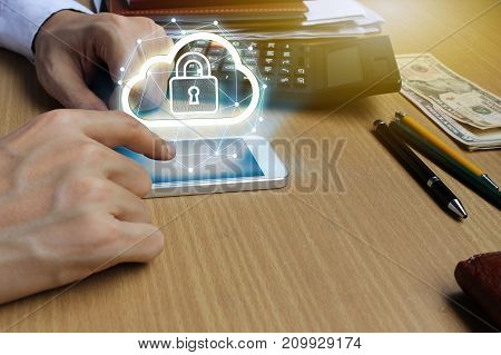 Businessman use Laptop and smartphone with padlock and cloud technology background Cyber Security Data Protection Business Technology Privacy concept Internet Concept of global business.