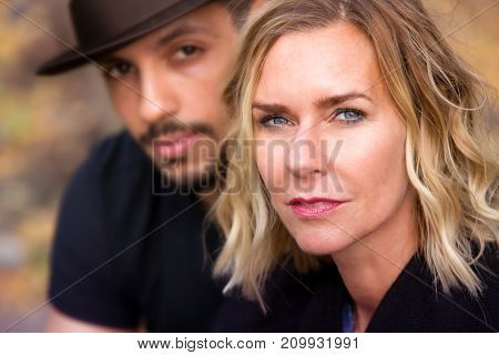 portrait of beautiful couple sitting outside in park