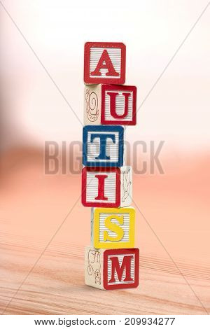 Toy blocks word autism color background colorful