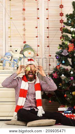 Man With Beard Holds Golden Christmas Balls