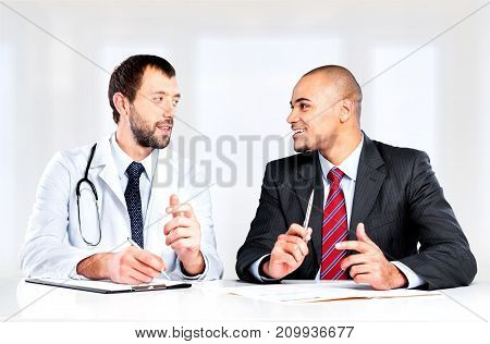 Male doctor patient computer background happy female
