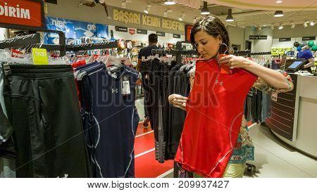 Eskisehir Turkey - August 11 2017: Young woman looking at a sports wear in a sports shop in Eskisehir.