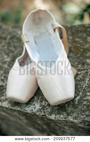 Pointe Shoes For A Classical Ballerina, Close-up On Concrete