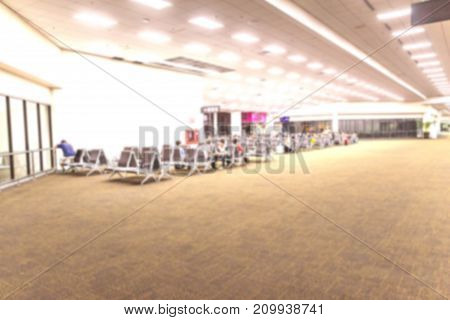 Abstract blur background of passengers awaiting bording at airport in night time Bangkok ThailandAbstract blur background of passengers awaiting boarding at airport in night time Bangkok Thailand