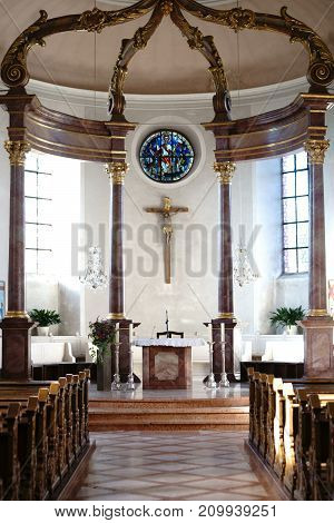 NIEDER-OLM, GERMANY - OCTOBER 14: The altar and interior of the Catholic parish church of St. Georg on October 14, 2017 in Nieder-Olm.