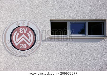 TAUNUSSTEIN-WEHEN, GERMANY - OCTOBER 15: The coat of arms of the sports club SV Wehen Wiesbaden on the facade of a club building on October 15, 2017 in Taunusstein-Wehen.