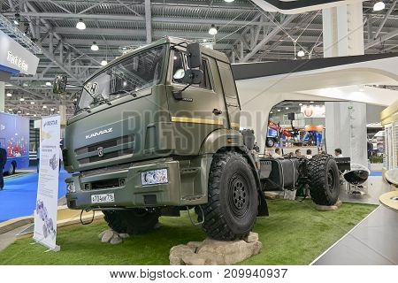 MOSCOW, SEP, 5, 2017: Powerful green Kamaz heavy mud truck exhibit on Commercial Transport Exhibition ComTrans-2017. Russian special off road mud trucks. Best russian cars trucks. Heavy mud truck