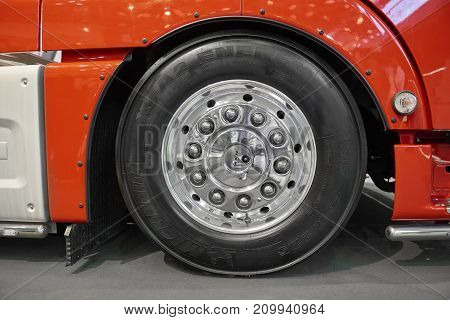 MOSCOW, SEP, 5, 2017: View on MAN truck front wheels and tires. Truck wheel rim. Truck chassis exhibit on Commercial Transport Exhibition ComTrans-2017. Clean wheel. Road truck wheel