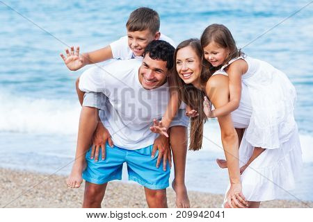 Happy family fun blue background isolated beautiful