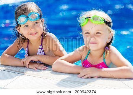 Pool fun girls blue happy closeup summer