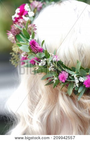 Close up of a flower wreath on a head (back view)